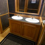 Majestic Restroom Trailer Marble sinks with framed mirror